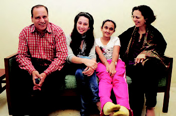 HAPPY TIMES: The Gour family at their Hamilton Court residence